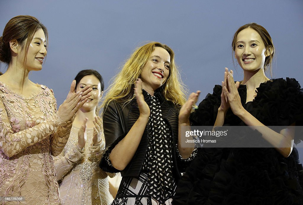 Center <a gi-track='captionPersonalityLinkClicked' href=/galleries/search?phrase=Alice+Temperley&family=editorial&specificpeople=213399 ng-click='$event.stopPropagation()'>Alice Temperley</a> during her fashion show which launched British Airways A380 'Gig On A Wing'. The acclaimed British designer Alice temperley MBE, was showing her Spring/Summer 2014 collection on October 24, 2013 in Hong Kong.