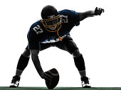 one center  american football player man in silhouette studio on white background