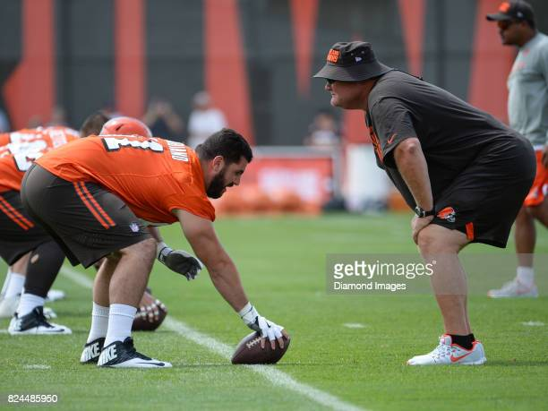Center Anthony Fabiano of the Cleveland Browns takes part in a dill as assistant offensive line coach Mark Hutson looks on during a training camp...