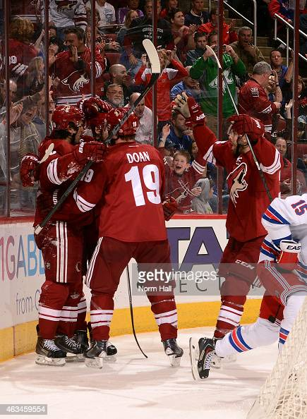Center Antoine Vermette of the Arizona Coyotes celebrates his second period goal with right wing Shane Doan during the NHL game against the New York...