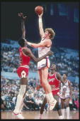 Center Bill Walton of the Los Angeles Clippers shoots the ball over center Caldwell Jones of the Chicago Bulls at the Los Angeles Sport Arena in Los...