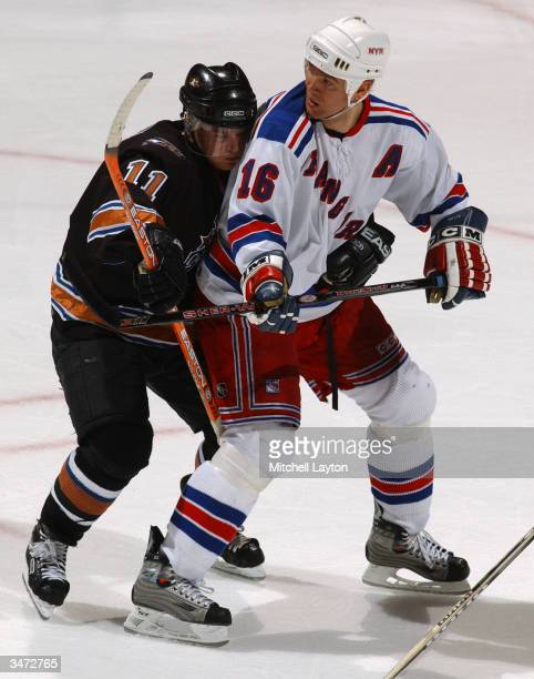 Center Bobby Holik the New York Rangers and center Jeff Halpern of the Washington Capitals jostle for position during the game at the MCI Center on...
