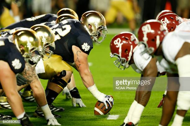 Center Braxston Cave of the University of Notre Dame prepares to snap the ball against the University of Alabama during the Discover BCS National...