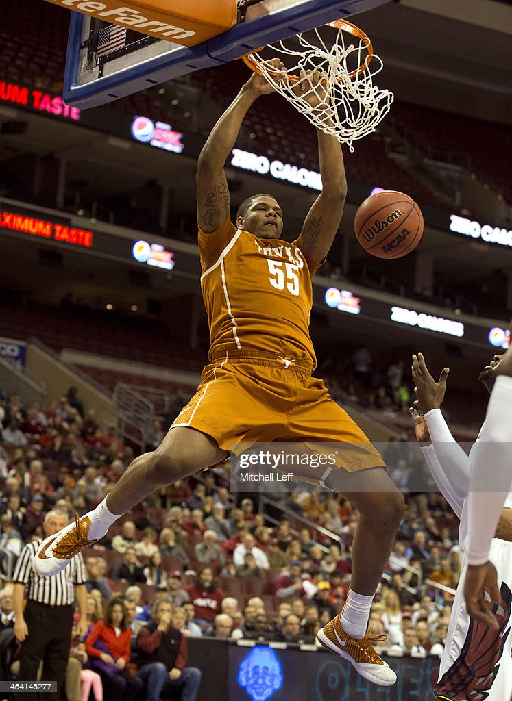 Center <a gi-track='captionPersonalityLinkClicked' href=/galleries/search?phrase=Cameron+Ridley&family=editorial&specificpeople=7887105 ng-click='$event.stopPropagation()'>Cameron Ridley</a> #55 of the University of Texas Longhorns dunks the ball against the Temple University Owls on December 7, 2013 at the Wells Fargo Center in Philadelphia, Pennsylvania.