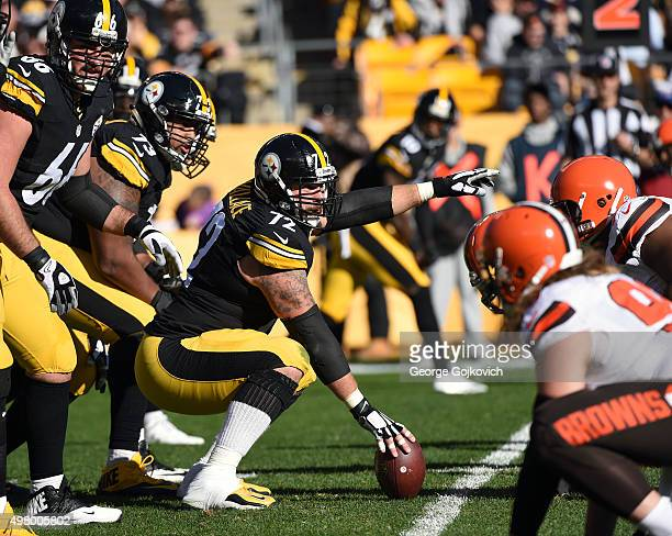 Center Cody Wallace of the Pittsburgh Steelers signals at the line of scrimmage as offensive linemen David DeCastro and Ramon Foster look on during a...