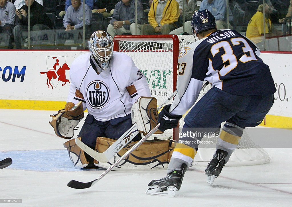 Center Colin Wilson #33 of the Nashville Predators, appearing in his first career NHL game, looks for a rebound against goalie Jeff Deslauriers #38 of the Edmonton Oilers on October 12, 2009 at the Sommet Center in Nashville, Tennessee.