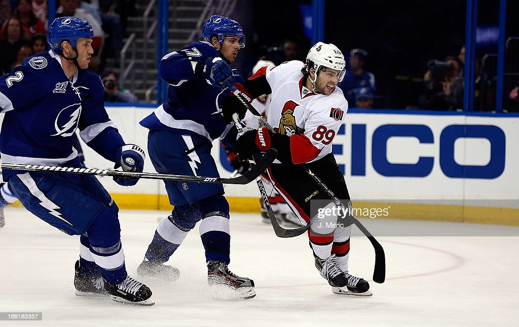 Center Cory Conacher #89 of the Ottawa Senators battles center Alex Killorn #17 of the Tampa Bay Lightning during the game at the Tampa Bay Times Forum on April 9, 2013 in Tampa, Florida.