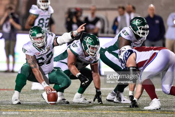 Center Dan Clark of the Saskatchewan Roughriders calls out the play against the Montreal Alouettes during the CFL game at Percival Molson Stadium on...