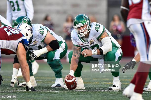Center Dan Clark of the Saskatchewan Roughriders prepares to play the ball against the Montreal Alouettes during the CFL game at Percival Molson...