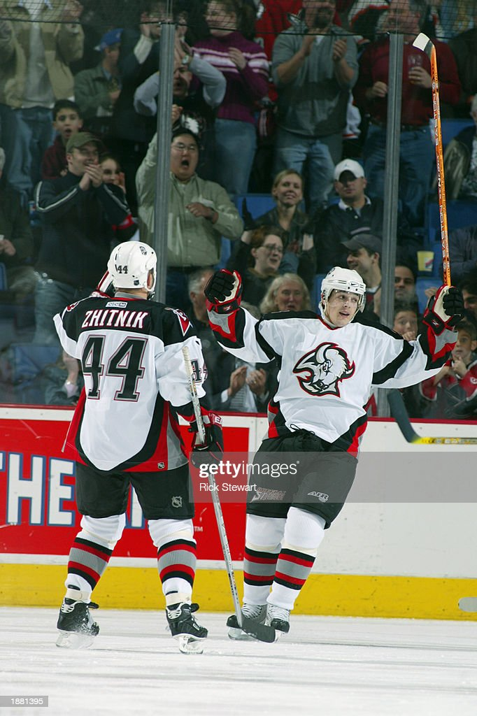 db5b545cf ... gallery of center daniel briere of the buffalo sabres celebrates with  teammate defenseman alexei zhitnik with ...