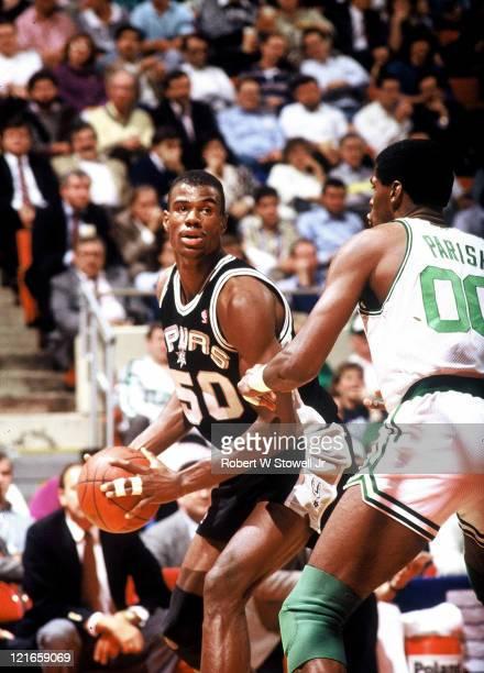Center David Robinson left of the San Antonio Spurs faces off against Boston Celtics center Robert Parish during a game in Hartford Connecticut 1988