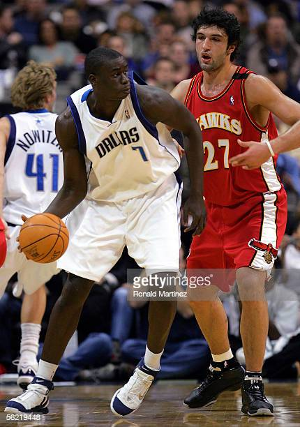 Center DeSagana Diop of the Dallas Mavericks moves the ball against Zaza Pachulia of the Atlanta Hawks at the American Airlines Center on November 17...