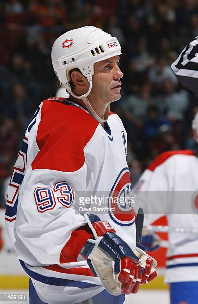 Center Doug Gilmour of the Montreal Canadiens looks on against the Toronto Maple Leafs during the NHL game on October 3 2002 at the Bell Centre in...