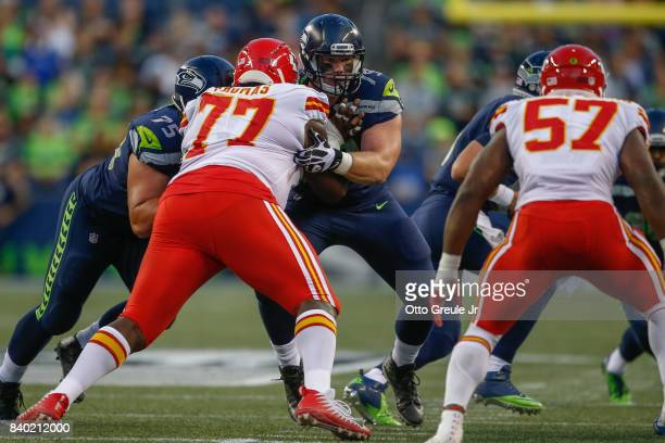 Center Ethan Pocic of the Seattle Seahawks blocks against Donald Hawkins of the Kansas City Chiefs at CenturyLink Field on August 25 2017 in Seattle...