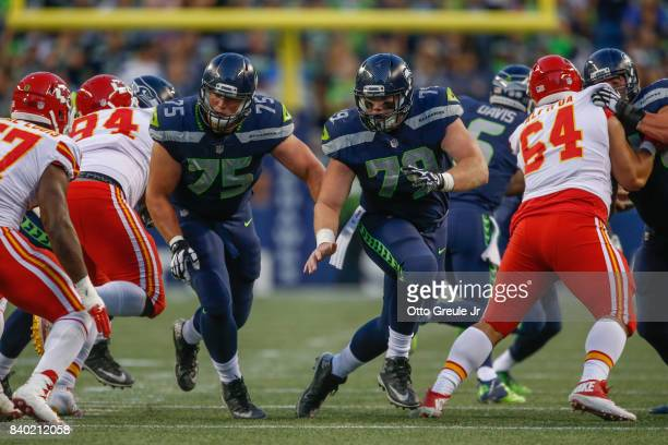 Center Ethan Pocic of the Seattle Seahawks blocks against the Kansas City Chiefs at CenturyLink Field on August 25 2017 in Seattle Washington