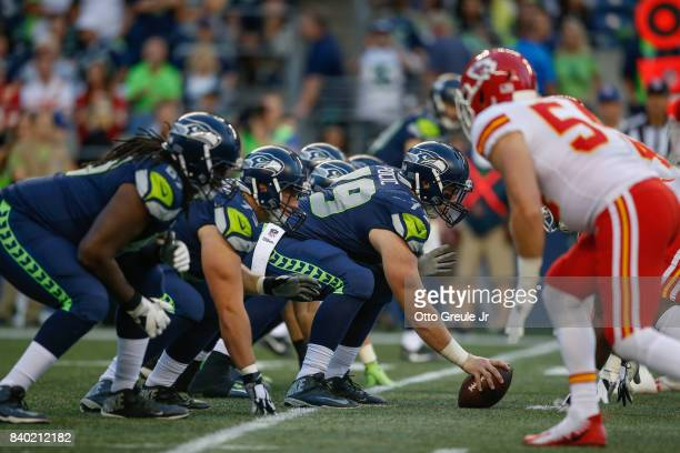 Center Ethan Pocic of the Seattle Seahawks lines up against the Kansas City Chiefs at CenturyLink Field on August 25 2017 in Seattle Washington
