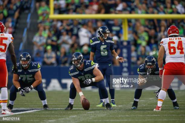 Center Ethan Pocic of the Seattle Seahawks lines up as quarterback Austin Davis looks over the defense against the Kansas City Chiefs at CenturyLink...
