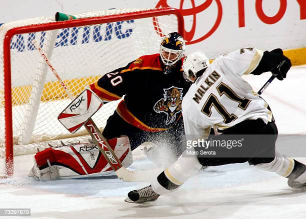 Center Evgeni Malkin of the Pittsburgh Penguins shoots against goalie Ed Belfour the Florida Panthers February 22 2007 at the BankAtlantic Center in...