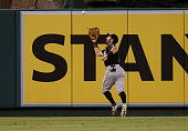 Center fielder Adam Eaton of the Chicago White Sox chases down a long drive by Johnny Giavotella of the Los Angeles Angels of Anaheim to end the...