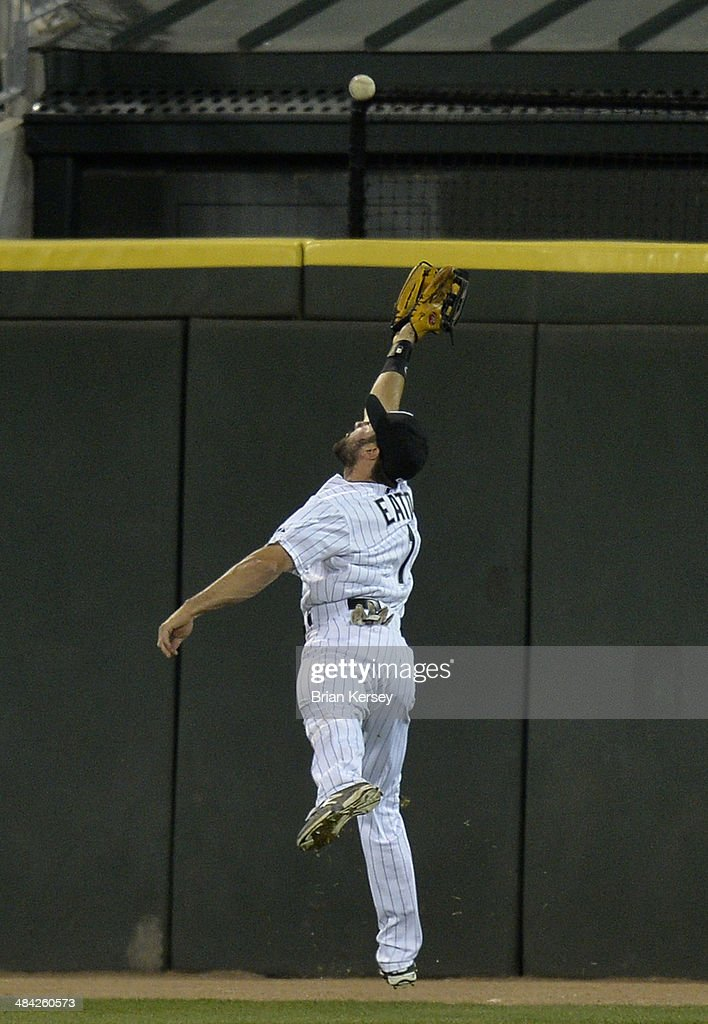 Center fielder <a gi-track='captionPersonalityLinkClicked' href=/galleries/search?phrase=Adam+Eaton&family=editorial&specificpeople=210898 ng-click='$event.stopPropagation()'>Adam Eaton</a> #1 of the Chicago White Sox reaches for but cannot get to an RBI ground-rule double hit by Elliot Johnson #30 of the Cleveland Indians during the fifth inning at U.S. Cellular Field on April 11, 2014 in Chicago, Illinois.