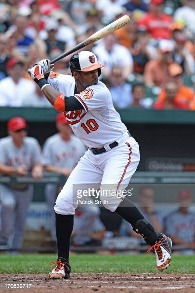 Center fielder Adam Jones of the Baltimore Orioles bats against the Los Angeles Angels of Anaheim at Oriole Park at Camden Yards on June 12 2013 in...
