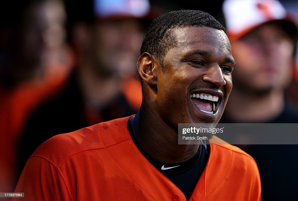 Center fielder Adam Jones #10 of the Baltimore Orioles celebrates after teammate Ryan Flaherty's (not pictured) three home run in the third inning against the New York Yankees at Oriole Park at Camden Yards on June 29, 2013 in Baltimore, Maryland.
