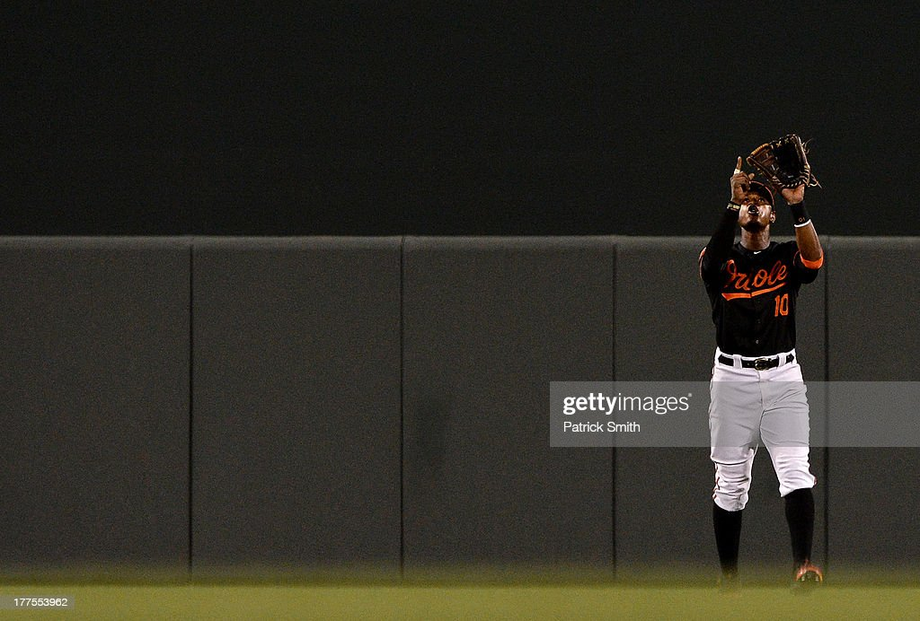 Center fielder Adam Jones #10 of the Baltimore Orioles celebrates after defeating the Oakland Athletics at Oriole Park at Camden Yards on August 23, 2013 in Baltimore, Maryland. The Baltimore Orioles won, 9-7.