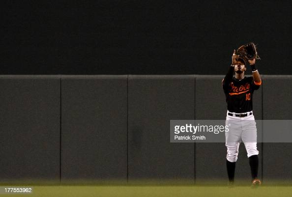 Center fielder Adam Jones of the Baltimore Orioles celebrates after defeating the Oakland Athletics at Oriole Park at Camden Yards on August 23 2013...