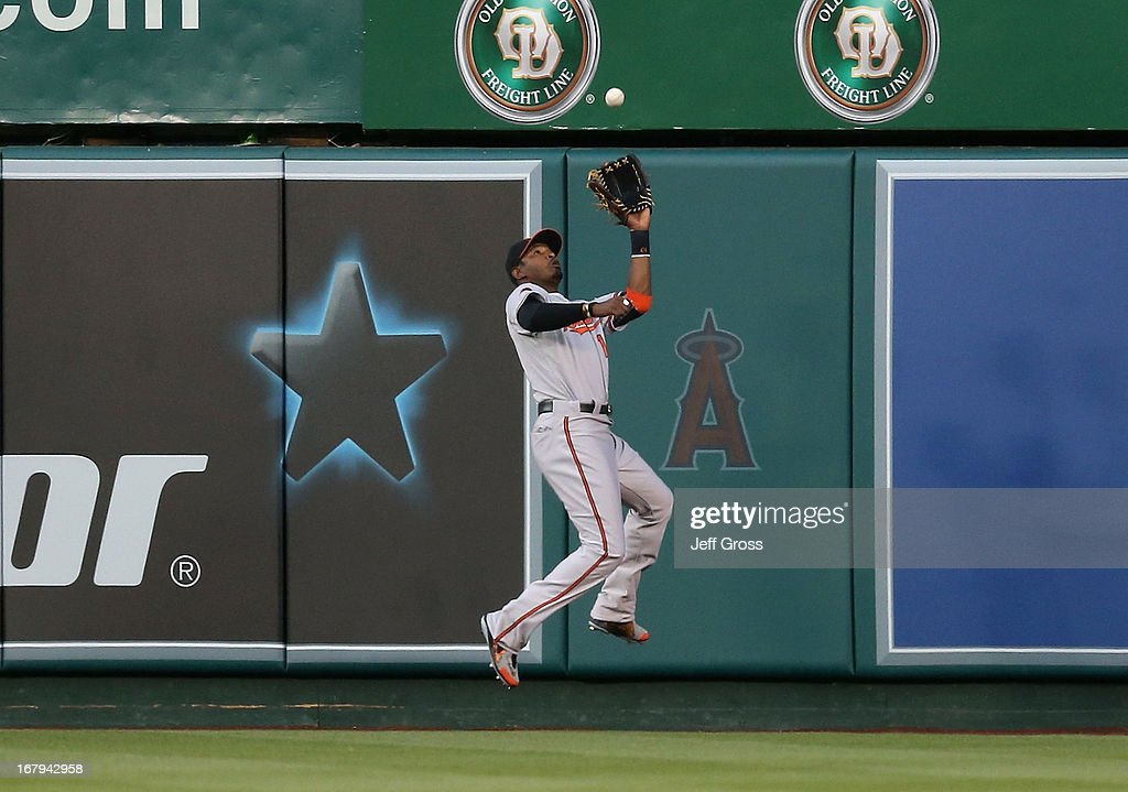 Center fielder Adam Jones #10 of the Baltimore Orioles makes a catch at the wall on a ball hit by Albert Pujols (not pictured) of the Los Angeles Angels of Anaheim in the first inning at Angel Stadium of Anaheim on May 2, 2013 in Anaheim, California. The Orioles defeated the Angels 5-1.