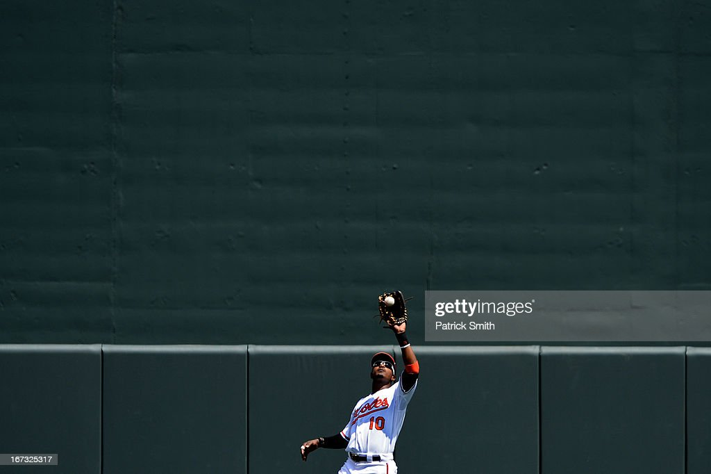 Center fielder Adam Jones #10 of the Baltimore Orioles makes a catch against the Toronto Blue Jays in the second inning at Oriole Park at Camden Yards on April 24, 2013 in Baltimore, Maryland.