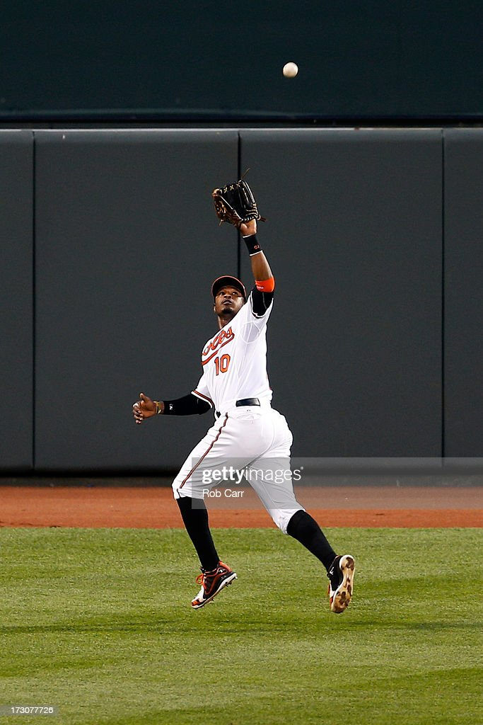 Center fielder Adam Jones #10 of the Baltimore Orioles makes a catch against the Cleveland Indians at Oriole Park at Camden Yards on June 25, 2013 in Baltimore, Maryland.