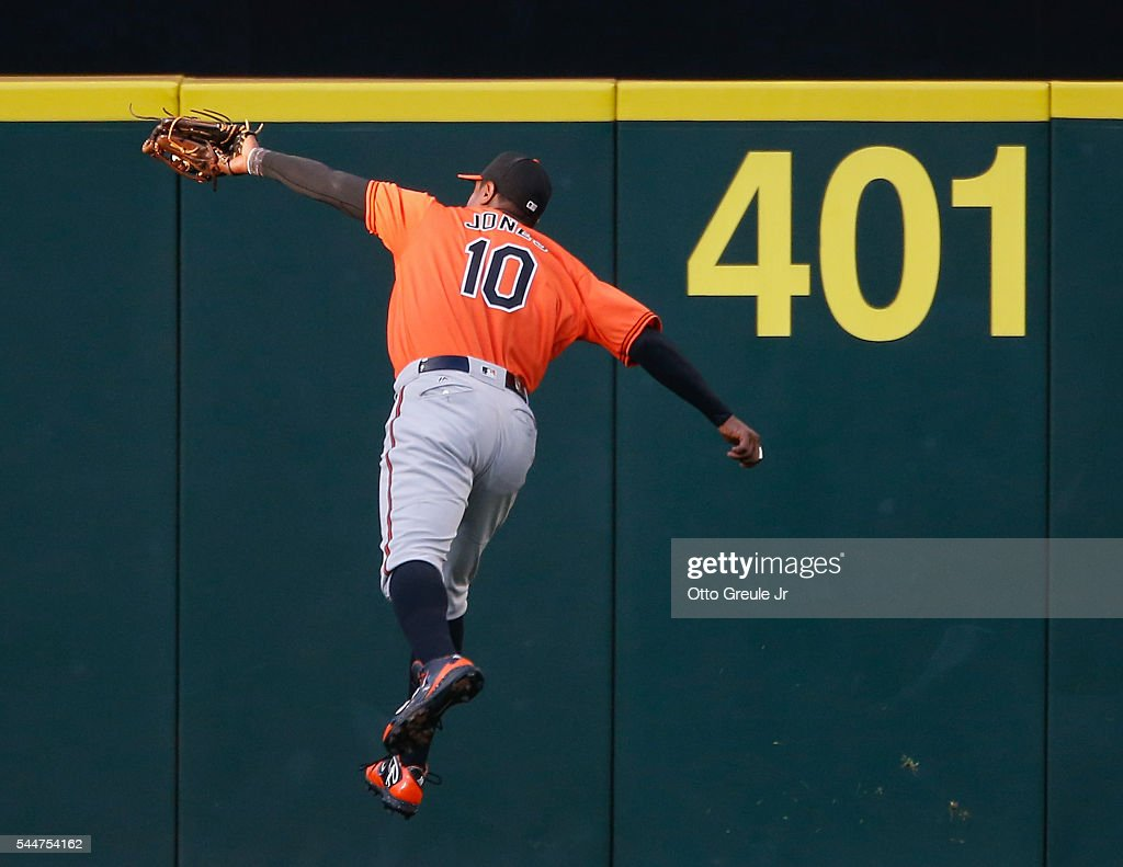 Center fielder Adam Jones of the Baltimore Orioles makes a leaping catch on a ball off the bat of Kyle Seager of the Seattle Mariners in the third...