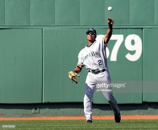 Center fielder Alex Sanchez of the Tampa Bay Devil Rays throws the ball back to the infield after making a catch against the Boston Red Sox on April...
