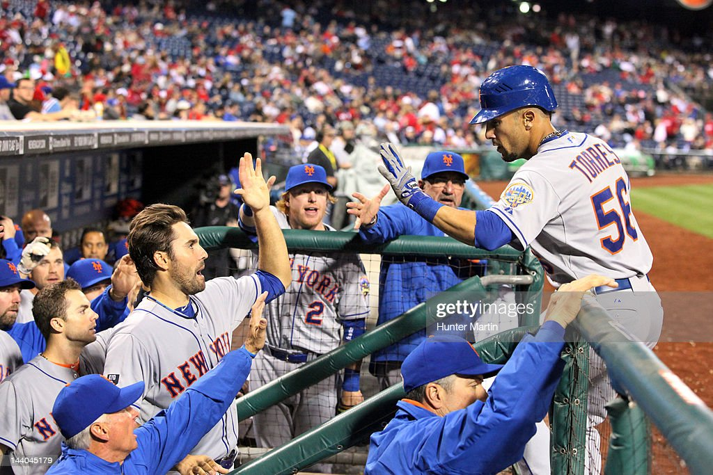 Center fielder <a gi-track='captionPersonalityLinkClicked' href=/galleries/search?phrase=Andres+Torres&family=editorial&specificpeople=835839 ng-click='$event.stopPropagation()'>Andres Torres</a> #56 of the New York Mets is congratulated by teammates after scoring a run during a game against the Philadelphia Phillies at Citizens Bank Park on May 8, 2012 in Philadelphia, Pennsylvania. The Mets won 7-4.