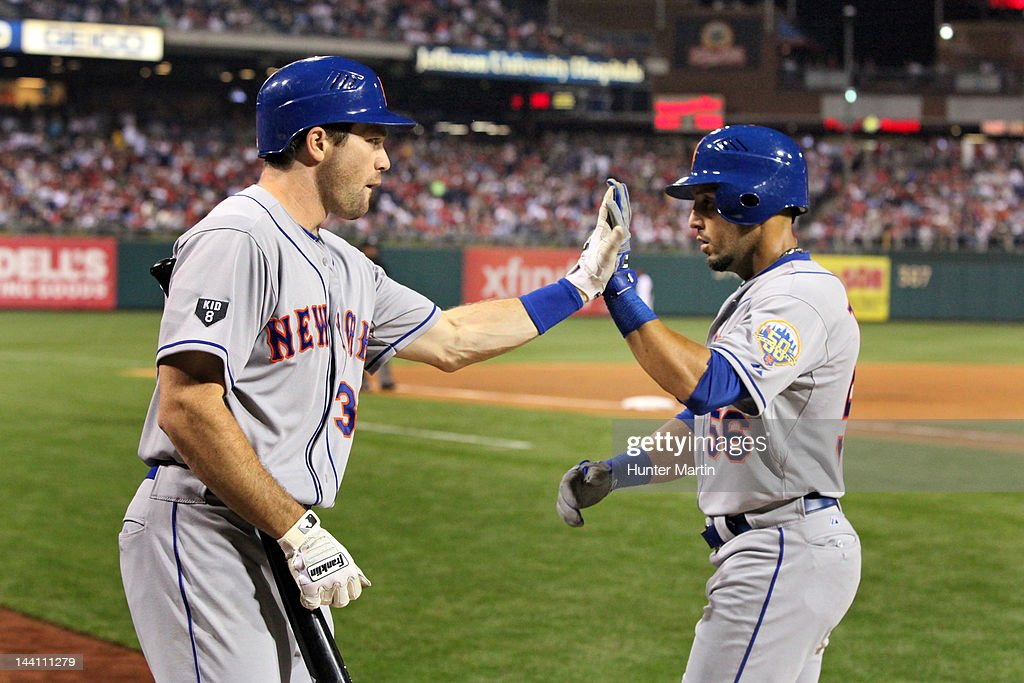 Center fielder <a gi-track='captionPersonalityLinkClicked' href=/galleries/search?phrase=Andres+Torres&family=editorial&specificpeople=835839 ng-click='$event.stopPropagation()'>Andres Torres</a> #56 of the New York Mets is congratulated by outfielder Vinny Rottino #33 after scoring a run during a game against the Philadelphia Phillies at Citizens Bank Park on May 9, 2012 in Philadelphia, Pennsylvania.