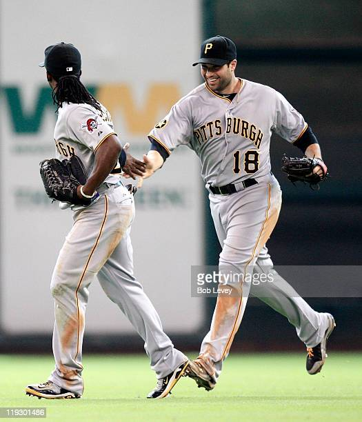 Center fielder Andrew McCutchen of the Pittsburgh Pirates is congratulated by Neil Walker after making a sliding catch on a fly ball off the bat of...