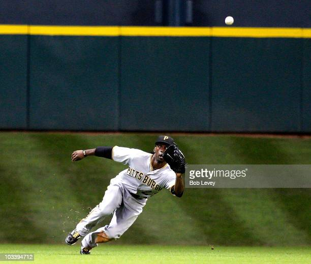 Center fielder Andrew McCutchen of the Pittsburgh Pirates makes a diving catch on a ball hit by Carlos Lee of the Houston Astros at Minute Maid Park...