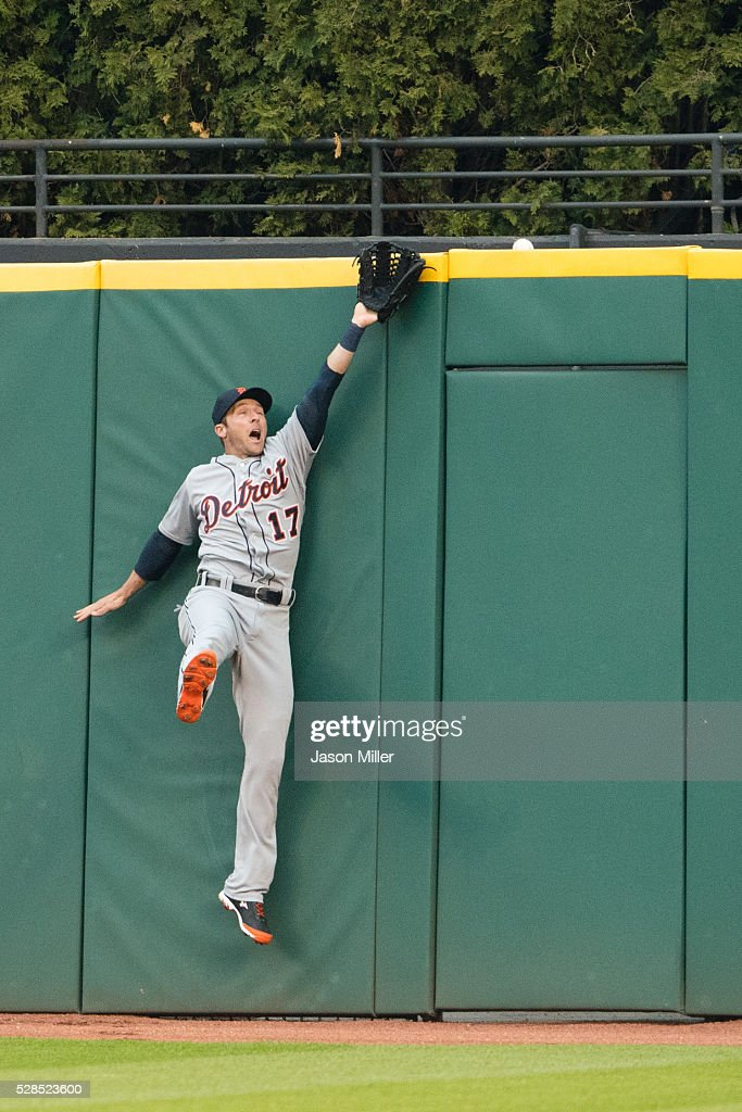 Center fielder <a gi-track='captionPersonalityLinkClicked' href=/galleries/search?phrase=Andrew+Romine&family=editorial&specificpeople=2338123 ng-click='$event.stopPropagation()'>Andrew Romine</a> #17 of the Detroit Tigers can't get to a home run hit by Chris Gimenez #38 of the Cleveland Indians during the fourth inning at Progressive Field on May 5, 2016 in Cleveland, Ohio.