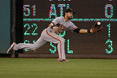 Center fielder Angel Pagan of the San Francisco Giants catches a ball hit by Ian Desmond of the Washington Nationals for the first out of the fourth...