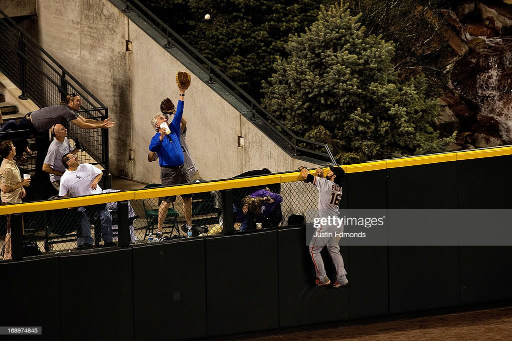 Center fielder <a gi-track='captionPersonalityLinkClicked' href=/galleries/search?phrase=Angel+Pagan&family=editorial&specificpeople=666596 ng-click='$event.stopPropagation()'>Angel Pagan</a> #16 of the San Francisco Giants climbs the wall and watches a solo home run by Carlos Gonzalez #5 of the Colorado Rockies (not pictured) fly over the fence during the sixth inning at Coors Field on May 17, 2013 in Denver, Colorado.
