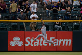 Center fielder Angel Pagan of the San Francisco Giants makes a leaping catch at the wall to rob a hit from Todd Helton of the Colorado Rockies for...