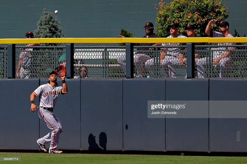 Center fielder <a gi-track='captionPersonalityLinkClicked' href=/galleries/search?phrase=Angel+Pagan&family=editorial&specificpeople=666596 ng-click='$event.stopPropagation()'>Angel Pagan</a> #16 of the San Francisco Giants makes a catch on the warning track for the third out of the eighth inning against the Colorado Rockies at Coors Field on September 1, 2014 in Denver, Colorado. The teams were resuming a game previously suspended in the sixth inning on May 22 due to rain. The Giants defeated the Rockies 4-2.