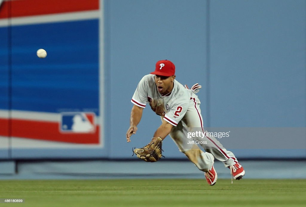 Center fielder <a gi-track='captionPersonalityLinkClicked' href=/galleries/search?phrase=Ben+Revere&family=editorial&specificpeople=6826641 ng-click='$event.stopPropagation()'>Ben Revere</a> #2 of the Philadelphia Phillies makes a catch on a ball hit by Matt Kemp of the Los Angeles Dodgers in the sixth inning at Dodger Stadium on April 22, 2014 in Los Angeles, California.