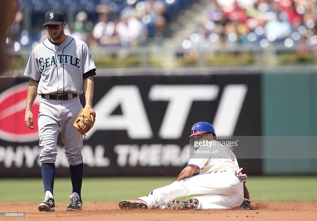 Center fielder <a gi-track='captionPersonalityLinkClicked' href=/galleries/search?phrase=Ben+Revere&family=editorial&specificpeople=6826641 ng-click='$event.stopPropagation()'>Ben Revere</a> #2 of the Philadelphia Phillies steals second base with shortstop <a gi-track='captionPersonalityLinkClicked' href=/galleries/search?phrase=Chris+Taylor+-+Baseball+Player&family=editorial&specificpeople=13511734 ng-click='$event.stopPropagation()'>Chris Taylor</a> #1 of the Seattle Mariners covering the base on the play in the bottom of the first inning on August 20, 2014 at Citizens Bank Park in Philadelphia, Pennsylvania.