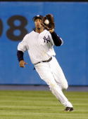 Center fielder Bernie Williams of the New York Yankees makes a catch against the Chicago Cubs on June 17 2005 at Yankee Stadium in the Bronx borough...