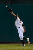 Center fielder Billy Burns of the Oakland Athletics catches a high line drive for an out against of the Los Angeles Angels of Anaheim to end the top...