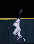 Center fielder Brad Miller of the Seattle Mariners makes a leaping catch on a ball off the bat of Marwin Gonzalez of the Houston Astros in the second...