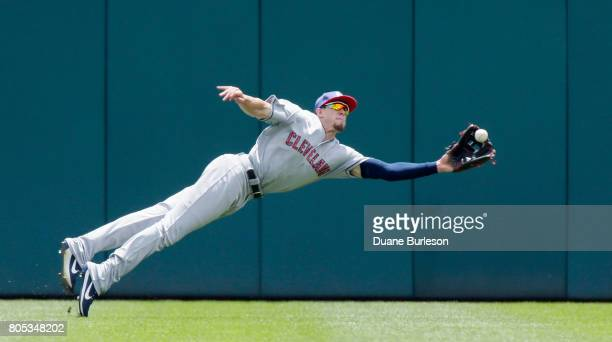 Center fielder Bradley Zimmer of the Cleveland Indians lays out to catch a fly ball hit by Mikie Mahtook of the Detroit Tigers in the first game of a...