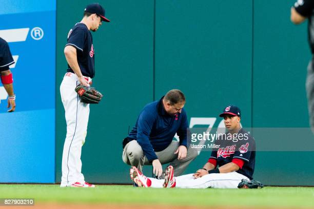 Center fielder Bradley Zimmer watches as a team trainer attends to left fielder Michael Brantley of the Cleveland Indians after Brantley suffered an...