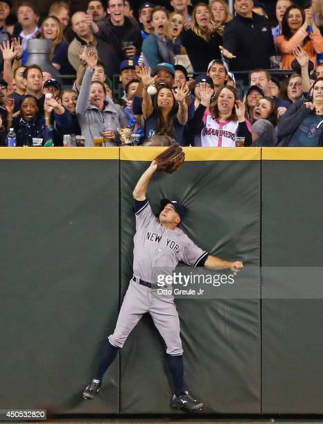 Center fielder Brett Gardner of the New York Yankees makes a catch at the wall on a deep fly off the bat of Mike Zunino of the Seattle Mariners in...